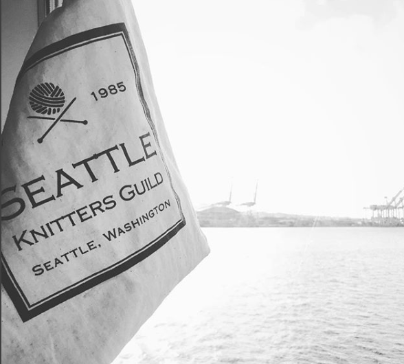 Cotton drawstring bag with Seattle Knitters Guild Logo