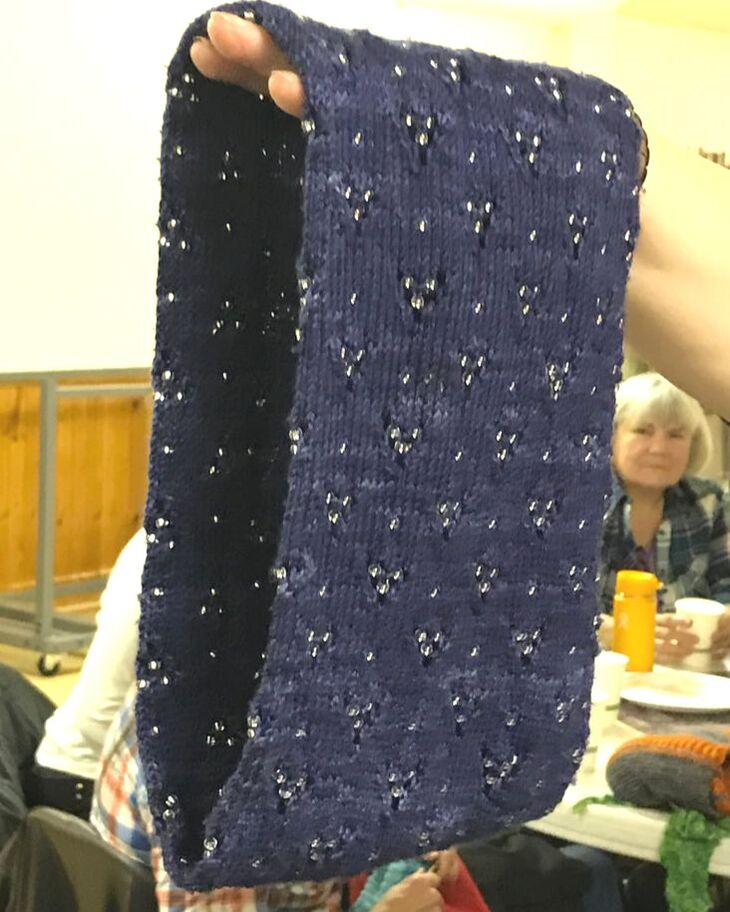 Cowl knitted in navy wool with starry lace pattern